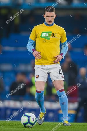 Declan Rice (West Ham) warming up in his 'Kick It Out' T-shirt on ahead of the Premier League match between Chelsea and West Ham United at Stamford Bridge, London