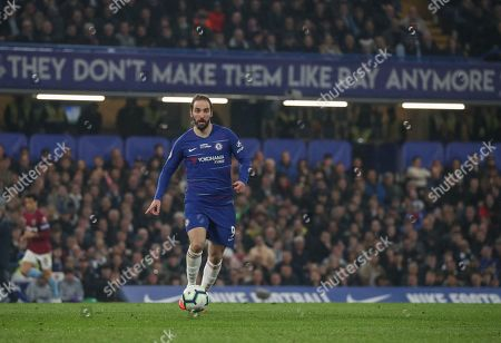 Gonzalo Higuain of Chelsea with Ray Wilkins Banner in background