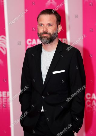 Stock Photo of Baran Bo Odar, jury President of the Cannes Series, poses on the pink carpet during the Cannes Series Festival in Cannes, 08 April 2019. The event will take place from 05 to 10 April.