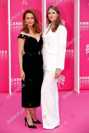Stock Picture of Cast member of 'The Outbreak', Russian actresses Viktoriya Isakova (L) and Maryana Spivak (R) pose on the pink carpet during the Cannes Series Festival in Cannes, 07 April 2019. The event will take place from 05 to 10 April.