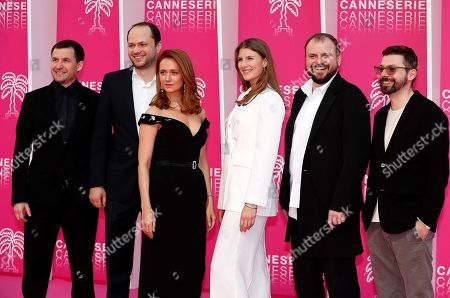 Stock Photo of Cast members of 'The Outbreak', Russian actors Viktoriya Isakova (3-L), Maryana Spivak (3-R) and Russian creator Roman Kantor (R) pose on the pink carpet during the Cannes Series Festival in Cannes, 07 April 2019. The event will take place from 05 to 10 April.