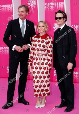 Cast members of 'Bauhaus', German actors August Diehl (L), Anna Maria Muhe (C) and German producer Lars Kraume (R) pose on the pink carpet during the Cannes Series Festival in Cannes, 07 April 2019. The event will take place from 05 to 10 April.