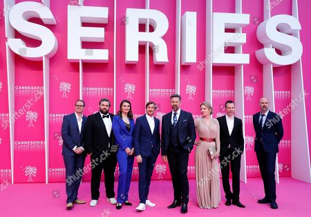 Cast members of 'The Twelve', Belgian actors Johan Heldenbergh (4-R), Maaike Cafmeyer (3-R), Belgian creators Bert Van Dael (3-L), Sanne Nuyens (4-L) and Belgian producer Wouter Bouvijn (2-R) pose on the pink carpet during the Cannes Series Festival in Cannes, 08 April 2019. The event will take place from 05 to 10 April.