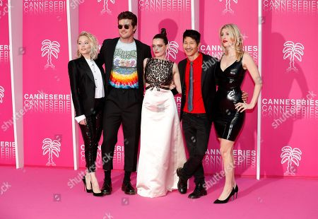 Stock Image of Cast members of 'Now Apocalypse', US actors Kelli Berglund (L), Beau Mirchoff (2-L), French actress Roxane Mesquida (C), US producer Gregg Araki (2-R) and US producer and writer Karley Sciortino (R) pose on the pink carpet during the Cannes Series Festival in Cannes, 08 April 2019. The event will take place from 05 to 10 April.