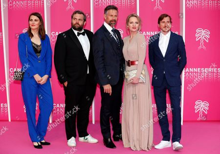 Cast members of 'The Twelve', Belgian actors Johan Heldenbergh (C), Maaike Cafmeyer (2-R), Belgian creators Bert Van Dael (L), Sanne Nuyens (2-L) and Belgian producer Wouter Bouvijn (R) pose on the pink carpet during the Cannes Series Festival in Cannes, France, 08 April 2019. The event will take place from 05 to 10 April.