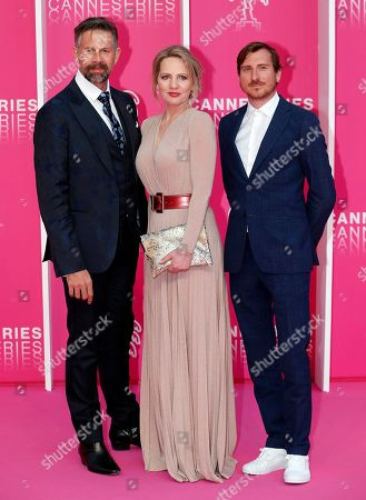 Stock Picture of Cast members of 'The Twelve', Belgian actors Johan Heldenbergh (L), Maaike Cafmeyer (C) and Belgian producer Wouter Bouvijn (R) pose on the pink carpet during the Cannes Series Festival in Cannes, 08 April 2019. The event will take place from 05 to 10 April.