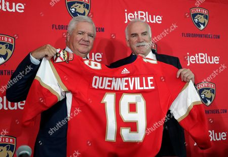 Florida Panthers General Manager Dale Tallon, left, and Joel Quenneville, right, pose for a photograph after Quenneville was introduced as the Florida Panthers new head coach at a news conference, in Sunrise, Fla