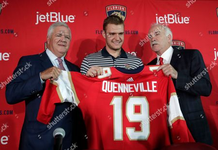 Florida Panthers General Manager Dale Tallon, left, captain Aleksander Barkov, of Finland, center, and Joel Quenneville, right, pose for a photograph after Quenneville was introduced as the Florida Panthers new head coach at a news conference, in Sunrise, Fla