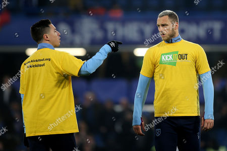 Samir Nasri and Marko Arnautovic of West Ham wear a Kick it Out T-Shirt in the pre-match warm up during Chelsea vs West Ham United, Premier League Football at Stamford Bridge on 8th April 2019