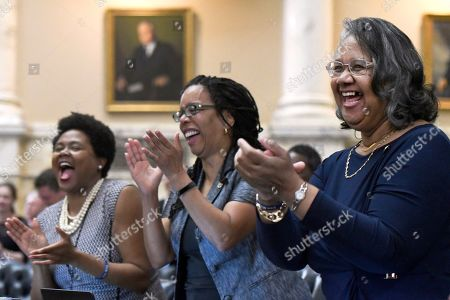 Stock Image of From left, Rep. Melissa Wells, Rep. Robbyn Lewis and Rep. Cheryl Glenn, all Baltimore City democrats, applaud in the Maryland House of Delegates chamber in Annapolis, Md., the final day of the state's 2019 legislative session