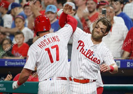 Philadelphia Phillies' Rhys Hoskins, left, celebrates his home run with Bryce Harper, right, during the sixth inning of a baseball game against the Washington Nationals, in Philadelphia