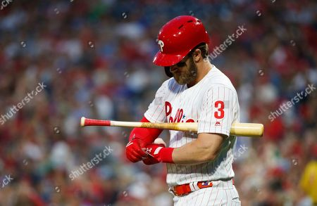 Philadelphia Phillies' Bryce Harper comes up to his at bat during the first inning of a baseball game against the Washington Nationals, in Philadelphia