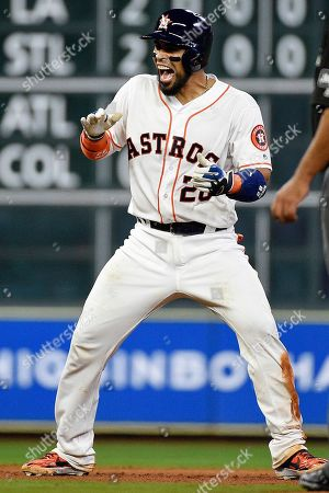 Houston Astros' Robinson Chirinos reacts after his game-tying two-run double during the seventh inning of a baseball game against the New York Yankees, in Houston
