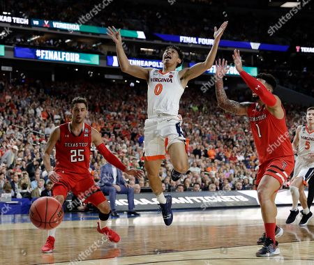 Virginia's Kihei Clark (0) loses the control of the ball against Texas Tech's Davide Moretti (25) and Brandone Francis (1) during the second half in the championship of the Final Four NCAA college basketball tournament, in Minneapolis