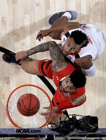 Texas Tech's Brandone Francis, left, and Virginia's Braxton Key watches the ball go into the basket during the second half in the championship of the Final Four NCAA college basketball tournament, in Minneapolis