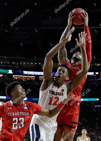Texas Tech's Brandone Francis grabs a rebound against Virginia's De'Andre Hunter (12) during the second half in the championship of the Final Four NCAA college basketball tournament, in Minneapolis