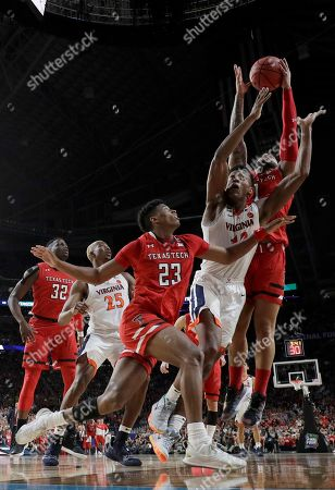 Texas Tech's Brandone Francis (1) grabs a rebound over Virginia's De'Andre Hunter (12) Virginia's Kody Stattmann (23) during the second half in the championship of the Final Four NCAA college basketball tournament, in Minneapolis