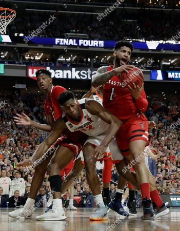 Texas Tech's Brandone Francis (1) grains a rebound against Virginia's De'Andre Hunter (12) during the second half in the championship of the Final Four NCAA college basketball tournament, in Minneapolis