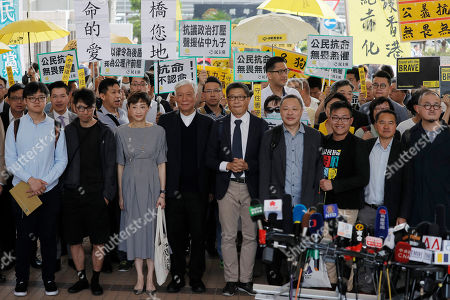 """Shiu Ka Chun, Lee Wing Tat, Raphael Wong, Benny Tai, Chan Kin Man, Chu Yiu Ming, Tanya Chan, Eason Chung, Tommy Cheung. Occupy Central leaders, from right, Shiu Ka Chun, Lee Wing Tat, Raphael Wong, Benny Tai, Chan Kin Man, Chu Yiu Ming, Tanya Chan, Eason Chung and Tommy Cheung pose for photographers before entering a court in Hong Kong, . Nine leaders of the 2014 Hong Kong pro-democracy movement will hear the verdicts in their trial. The co-founders of the """"Occupy Central"""" campaign - legal Professor Benny Tai Yiu-Ting, sociology professor Chan Kin-man and retired pastor Chu Yiu-ming - are facing charges related to the planning and implementation of the campaign which became part of the large-scale pro-democracy Umbrella Movement protests which were carried out 79 days between September and December 2014"""