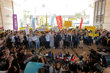 """Shiu Ka Chun, Lee Wing Tat, Raphael Wong, Benny Tai, Chan Kin Man, Chu Yiu Ming, Tanya Chan, Eason Chung, Tommy Cheung. Occupy Central leaders, from right, Shiu Ka Chun, Lee Wing Tat, Raphael Wong, Benny Tai, Chan Kin-man, Chu Yiu-ming, Tanya Chan, Eason Chung and Tommy Cheung pose for photographers before entering a court in Hong Kong, . Nine leaders of the 2014 Hong Kong pro-democracy movement hear the verdicts in their trial. The co-founders of the """"Occupy Central"""" campaign - legal Professor Benny Tai, sociology professor Chan Kin-man and retired pastor Chu Yiu-ming - are facing charges related to the planning and implementation of the campaign which became part of the large-scale pro-democracy Umbrella Movement protests which were carried out 79 days between September and December 2014"""