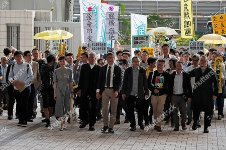 Shiu Ka Chun, Lee Wing Tat, Raphael Wong, Benny Tai, Chan Kin-man, Chu Yiu-ming, Tanya Chan, Eason Chung, Tommy Cheung. Occupy Central leaders from right; Shiu Ka Chun, Lee Wing Tat, Raphael Wong, Benny Tai, Chan Kin-man, Chu Yiu-ming, Tanya Chan, Eason Chung and Tommy Cheung arrive a court in Hong Kong, . Hong Kong court found nine leaders of 2014 pro-democracy demonstrations guilty Tuesday on public nuisance and other charges, a verdict that activists say likely presages more restrictions on free expression in the semi-autonomous Chinese territory