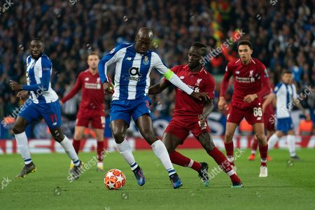Stock Picture of Porto?s Maxi Pereira under pressure from Liverpool's Sadio Mane 9th April 2019 , Anfield Stadium, Liverpool, England;  EUFA Champions League Quarter Final, First Leg, Liverpool FC vs FC Porto  Credit: Terry Donnelly/News Images