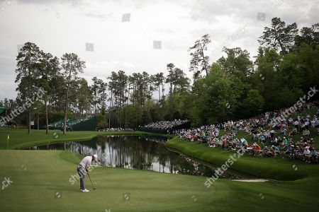 Trevor Immelman, of South Africa, putts on the 16th hole during a practice round for the Masters golf tournament, in Augusta, Ga
