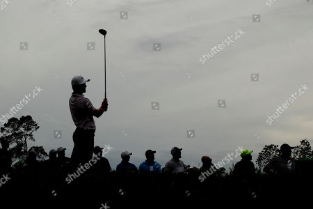 Trevor Immelman, of South Africa, watches his tee shot on the 18th hole during a practice round for the Masters golf tournament, in Augusta, Ga