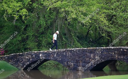 Tommy Fleetwood of England walks across the Nelson Bridge on the thirteenth hole during the second practice round for the 2019 Masters Tournament at the Augusta National Golf Club in Augusta, Georgia, USA, 09 April 2019. The 2019 Masters Tournament is held 11 April through 14 April 2019.