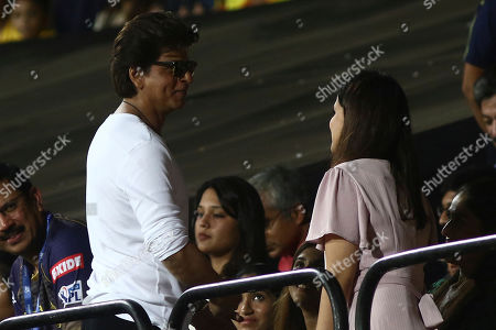 Bollywood star Shah Rukh Khan, left, talks to Shakshi Dhoni during the VIVO IPL T20 cricket match between Chennai Super Kings and Kolkata Knight Riders in Chennai, India