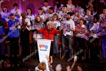 """Betty Boothroyd, aged 89, the former Speaker of the House of Commons in Britain's Parliament, gestures as she arrives on stage to address a People's Vote rally calling for a second referendum on Britain's European Union membership entitled """"The wind is changing on Brexit"""" in London"""