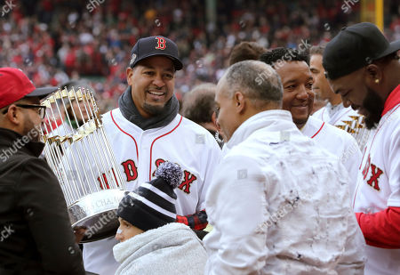 Manny Ramirez, Pedro Martinez, David Ortiz. Former Boston Red Sox star Manny Ramirez, left, holds the World Series trophy beside Pedro Martinez, second from right, and David Ortiz, right, before the home opener baseball game between the Red Sox and the Toronto Blue Jays, in Boston