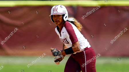 Alabama A&M base runner Tamia-Lee Barbadillo runs between bases during an NCAA softball game against Jackson State on in Huntsville, Ala