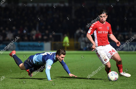 Josh Cullen of Charlton Athletic leaves Dominic Gape of Wycombe Wanderers in is wake