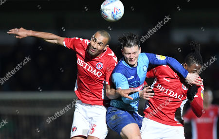 Darren Pratley of Charlton Athletic, Dominic Gape of Wycombe Wanderers and Joe Aribo of Charlton Athletic battle for the ball