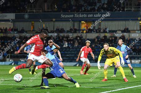 Igor Vetokele of Charlton Athletic under pressure from Sido Jombati of Wycombe Wanderers