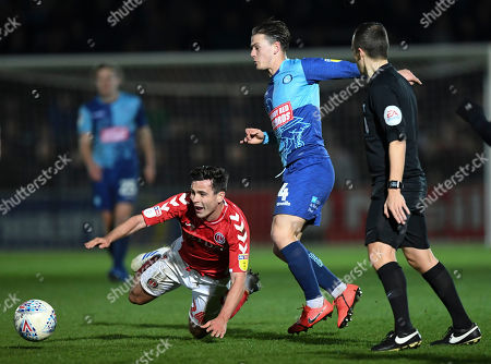 Josh Cullen of Charlton Athletic is fouled by  Dominic Gape of Wycombe Wanderers