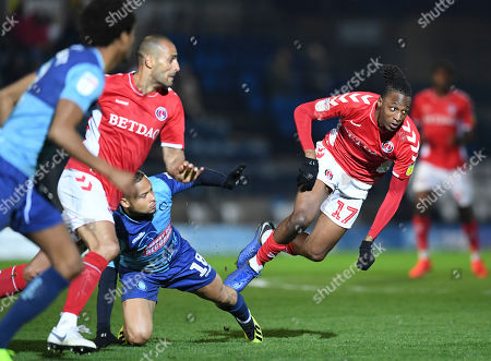 Joe Aribo of Charlton Athletic is fouled by  Curtis Thompson of Wycombe Wanderers