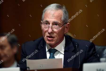 Cigna Corporation Executive Vice President and Chief Clinical Officer Steve Miller testifies before the Senate Finance Committee on Capitol Hill in Washington, during a hearing to explore the high cost of prescription drugs