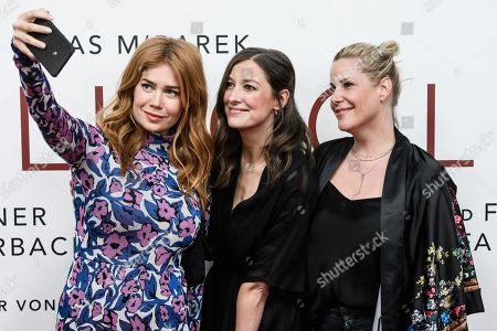 Stock Picture of German-Russian TV host and actress Palina Rojinski, German actress Alexandra Maria Lara and German screenwriter and director Anika Decker take selfie while they pose during the world premiere of the movie 'The Collini Case' (Der Fall Collini) at the Zoo Palast cinema in Berlin, Germany, 09 April 2019. The movie screens from 18 April 2019 in German cinemas.