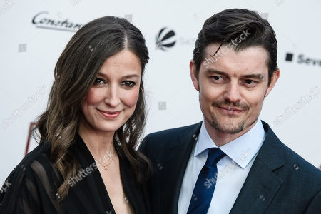 Alexandra Maria Lara (L) and her husband, British actor Sam Riley, pose during the world premiere of the movie 'The Collini Case' (Der Fall Collini) at the Zoo Palast cinema in Berlin, Germany, 09 April 2019. The movie screens from 18 April 2019 in German cinemas.