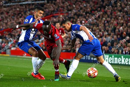 Porto's Jesus Corona, left, and Maxi Pereira tackle Liverpool's Sadio Mane during the Champions League quarterfinal, first leg, soccer match between Liverpool and FC Porto at Anfield Stadium, Liverpool, England