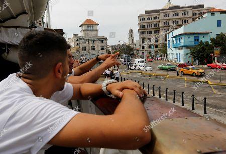 Members of the crew of the Spanish Navy's training ship Juan Sebastian de Elcano observe old Havana after arriving at the Port of Havana, in Havana, Cuba, 09 April 2019, where it will remain until the 14 April.