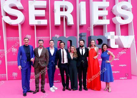 Cast members of 'Studio Tarara', Belgian actor Peter Van Den Begin (L), Geert Van Rampelberg (2-L), Belgian director Wim Geudens (3-L), Belgian producer Tim Van Alest (4-L), Belgian actresses Lauren Versnick (2-R) and Janne Desmet (R) pose on the pink carpet during the Cannes Series Festival in Cannes, 09 April 2019. The event runs from 05 to 10 April.