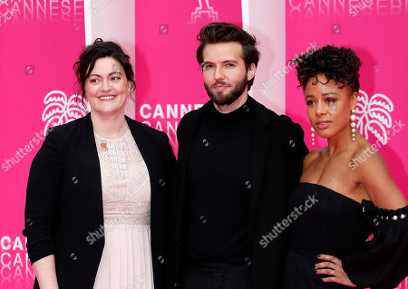 Cast members of 'The Feed', US producer Channing Powell (L), British actors Guy Burnet (C) and Nina Toussaint-White (R) pose on the pink carpet during the Cannes Series Festival in Cannes, 09 April 2019. The event runs from 05 to 10 April.