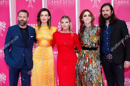 Stock Image of Jury members of Cannes Series, Swiss director Baran Bo Odar (L), French-British actress Emma Mackey 2-(L), Canadian actress Katheryn Winnick (C) Italian actress Miriam Leone (2-R) and French musician Robin Coudert Aka Rob (R) pose on the pink carpet during the Cannes Series Festival in Cannes, 09 April 2019. The event runs from 05 to 10 April.