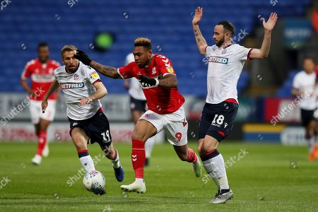 Britt Assombalonga of Middlesbrough battles for the ball with Marc Wilson of Bolton Wanderers and Gary O'Neil
