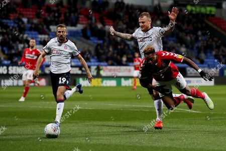 David Wheater of Bolton Wanderers and Britt Assombalonga of Middlesbrough