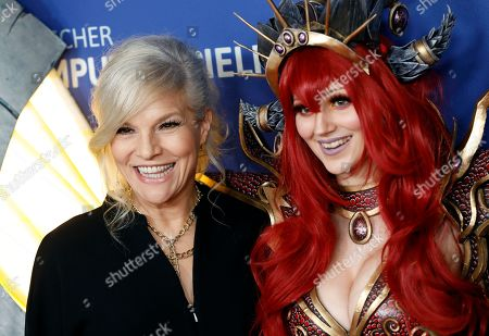 Stock Picture of German singer Ina Mueller (L) poses on the red carpet of the 'Gamesweekberlin' 2019 awards ceremony in Berlin, Germany, 09 April 2019. The fair is a seven-day event for games business and development in the German capital where representatives from the industry and games enthusiasts take part.