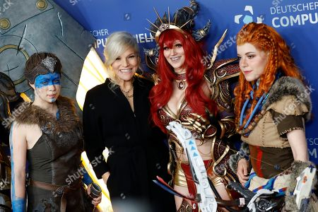 Stock Photo of German singer Ina Mueller (2-L) poses on the red carpet of the 'Gamesweekberlin' 2019 awards ceremony in Berlin, Germany, 09 April 2019. The fair is a seven-day event for games business and development in the German capital where representatives from the industry and games enthusiasts take part.